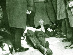 Lovett, dead on the floor on a Bridge Street saloon.